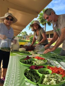 Prepping veggies for a Harvest Party at Kamali'i Elementary School.